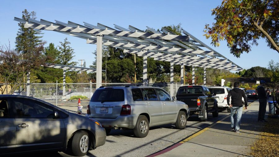 The foundation for solar panels stand as parents pick up students at Almond Elementary. The panels are expected to decrease carbon dioxide emissions by 3.5 million pounds per year and account for 90 percent of the district's energy needs. Kylie Akiyama.