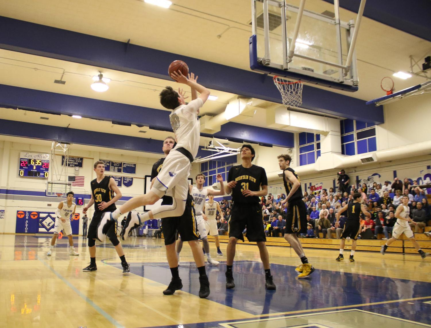 Senior Matt Eberle leaps up for a shot in Los Altos' 44-35 win over Mountain View at yesterday's Senior Night game.