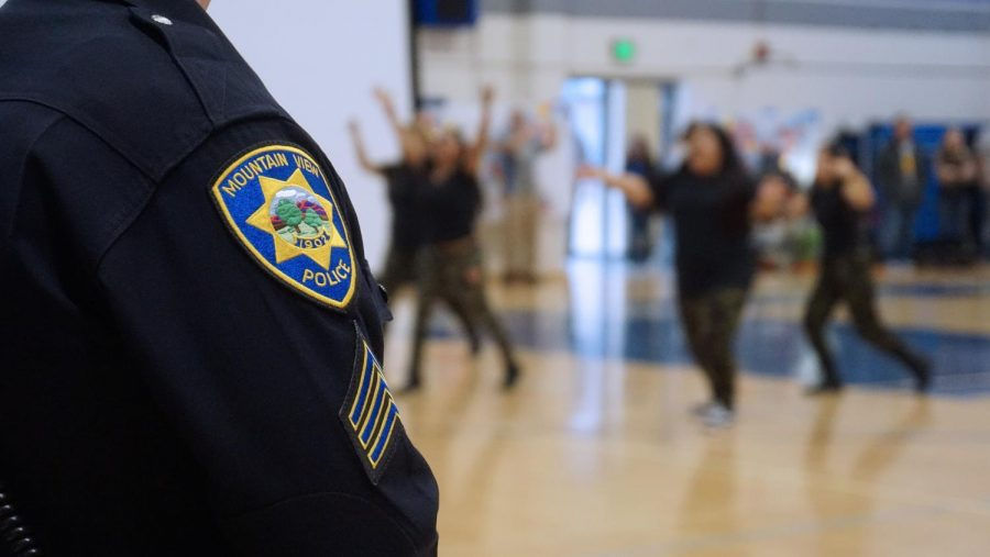 A Mountain View police officer watches over this morning's Diversity Assembly, which proceeded without incidence. Police increased their presence around Los Altos following a potential threat to the assembly. Kylie Akiyama.