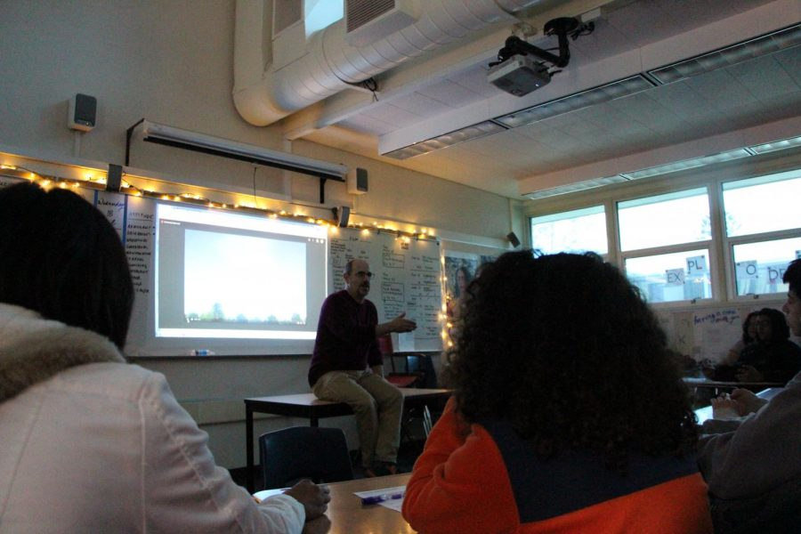 "New Media Literature teacher Robert Barker explains the importance of critical media literacy skills in front of his class. This year, the class had a shift in their structure while trying to maintain their motto, ""make or be made."""