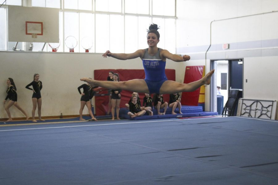 Gymnastics: Reaching for the high bar together