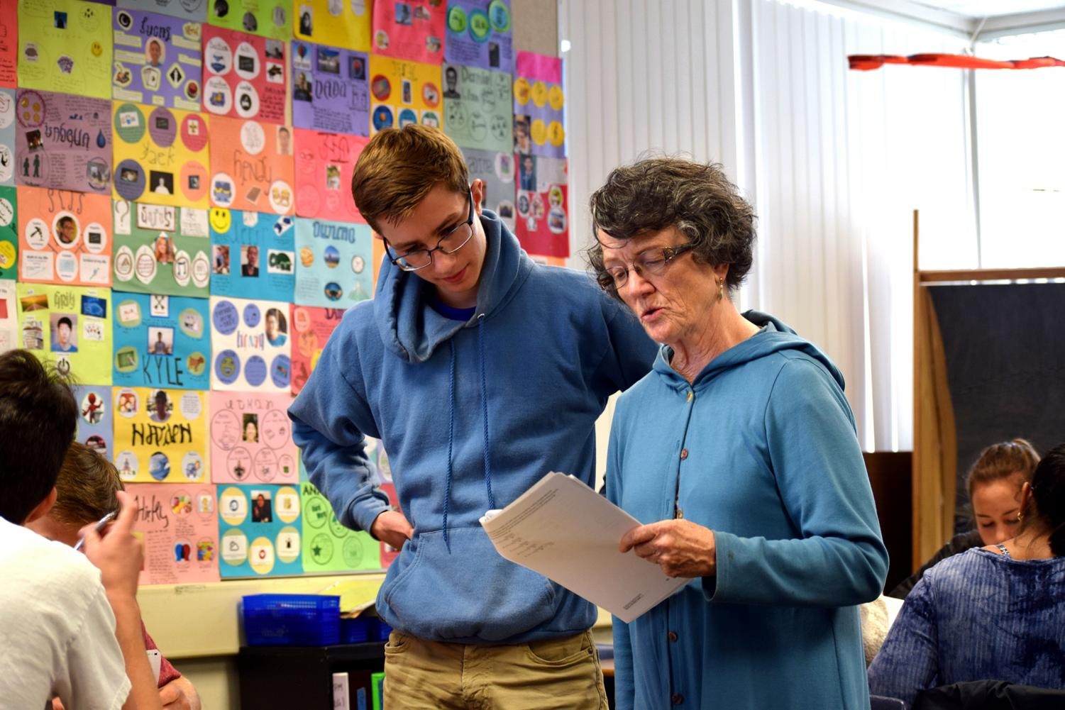 Math teacher Carol Evans helps senior Yann Sartori with test corrections. Known for her sharp wit and tough love, Evans worked to instill a love of learning in her students by prioritizing process over product. Francesca Fallow.
