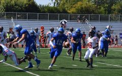 Varsity Football Dominates First League Game