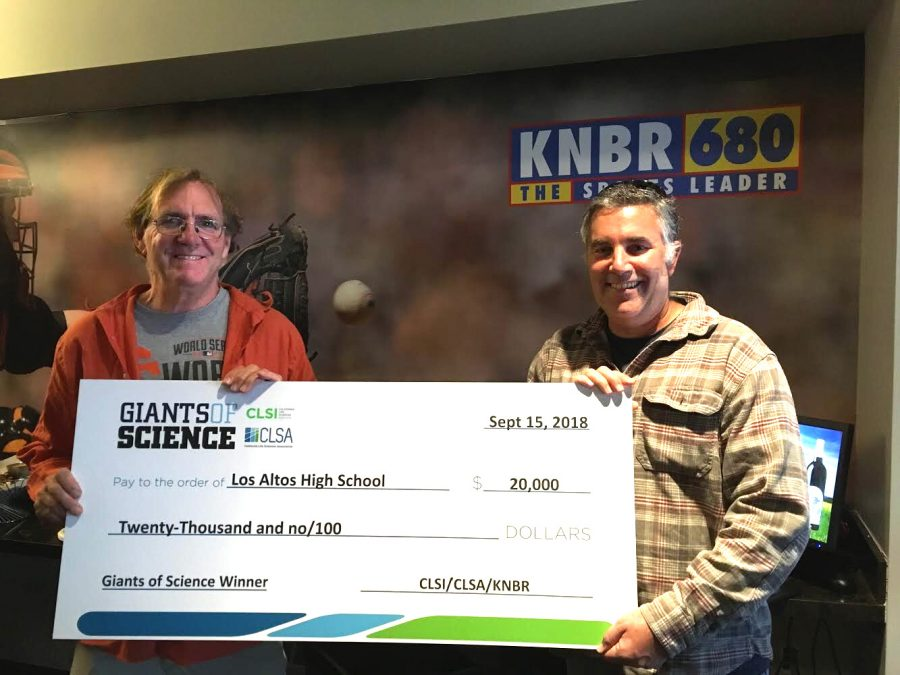 Environmental science teacher Greg Stoehr and biology teacher Jacob Russo hold the winning grant check for the Giants of Science competition. The money will go to fund Stoehr's bioprospecting project. Darren Dressen.