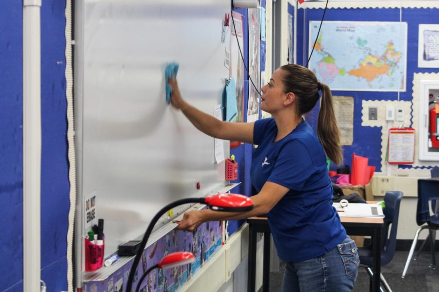 Custodian Lina Padilla cleans room 408. To show their appreciation, ASB surprised custodial staff with cards and gift bags as well as gratitude notes from other Los Altos students. Ishaan Parmar.