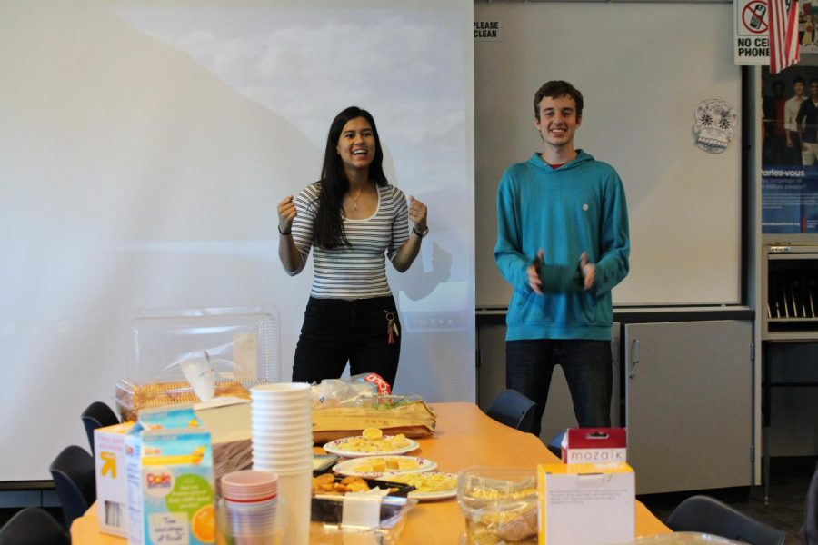 French Club co-presidents senior Katherine Houston and junior Aaron Feldman talk to club members in front of the food spread. French culture places a large emphasis on food and its ability to bring people together. Kylie Akiyama.
