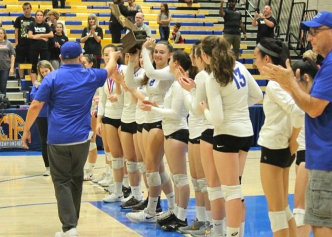 The varsity girls volleyball team after their game against Valley Christian. The 3-0 loss marked the end of the Los Altos's volleyball team's first-ever State final and a historic season.