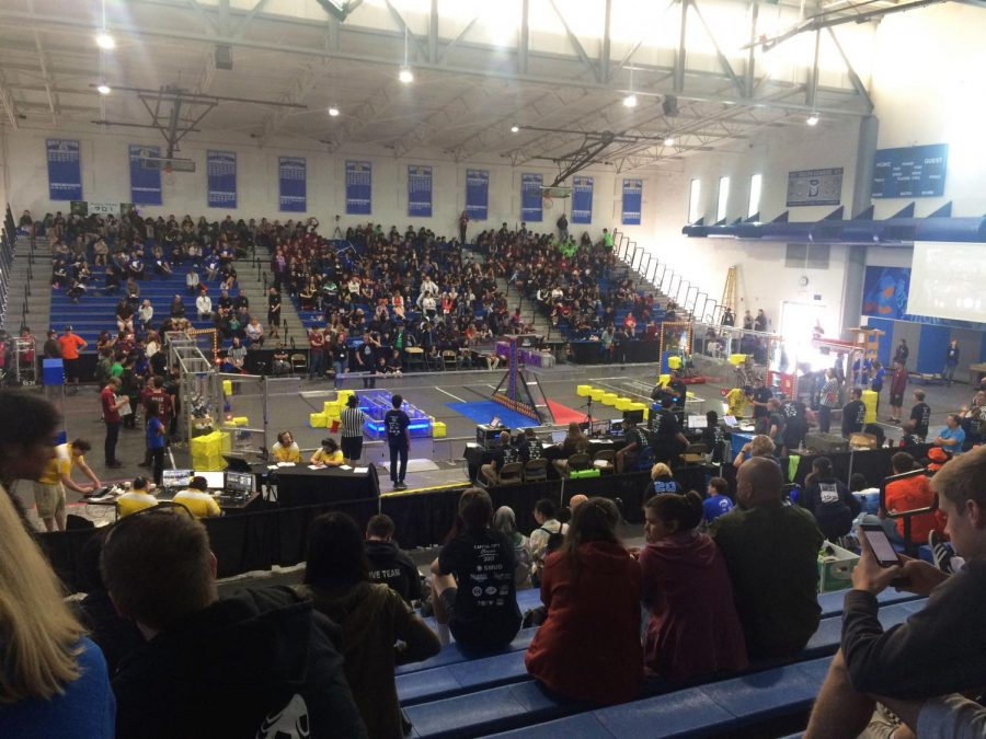 Eaglestrike prepares to compete before a match at the Capital City Classic. Their robot will need to climb and place cubes on three different scales. When competing, alliances of three teams must tip the scales towards their side, which earns them points by the second. Courtesy Matthew Lin.