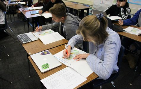 Freshmen Caden Maw and Dana Huch write in their Pre-AP booklets during their World History and Geography class, formerly World Studies. Both World Studies and Algebra 1 classes are implementing Pre-AP for the next two years.