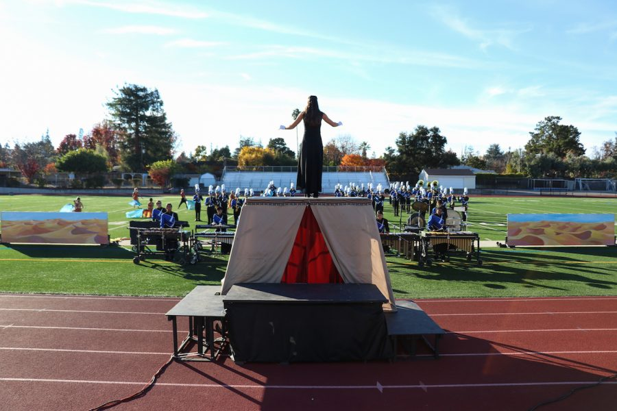 Drum major senior Francesca Seni leads the rest of marching band as they perform 3 pieces from their show called