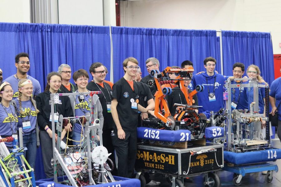 Los Altos' robotics team stands behind their robot, numbered 114, at the FIRST World Championship in Houston. This is their second time attending since the team was founded 22 years ago.
