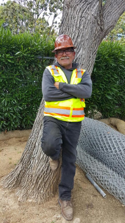 Electrician Eduardo Molina leans against a tree. Before moving to a new site, he worked on the electrical system of a new building at Los Altos.