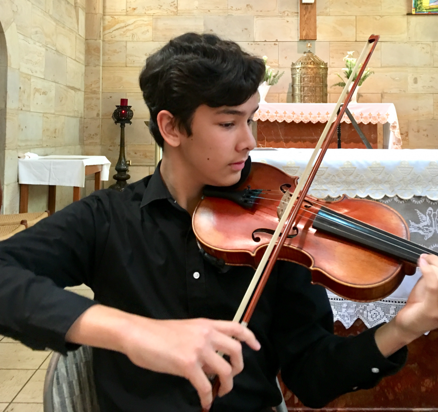 Evan skillfully performs the Double Violin Concerto in D minor at Maryknoll Chapel. He is currently composing violin motifs for characters in his novel