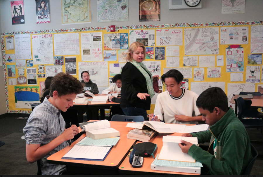 Latin teacher Krista Greksouk helps sophomore Ceasar Palting as the students decipher texts together.