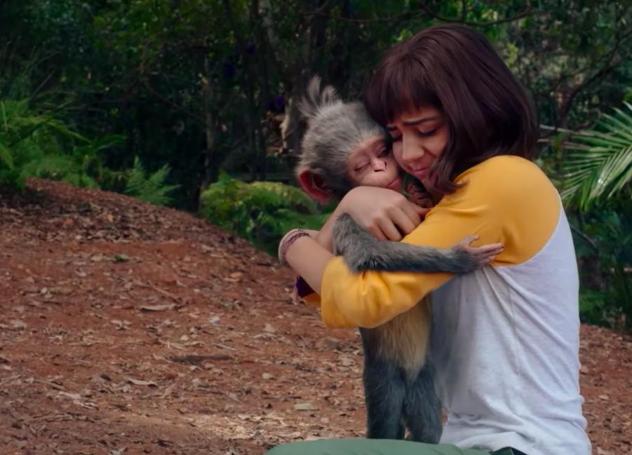 Dora, now a teenager, hugs pet monkey Boots goodbye.