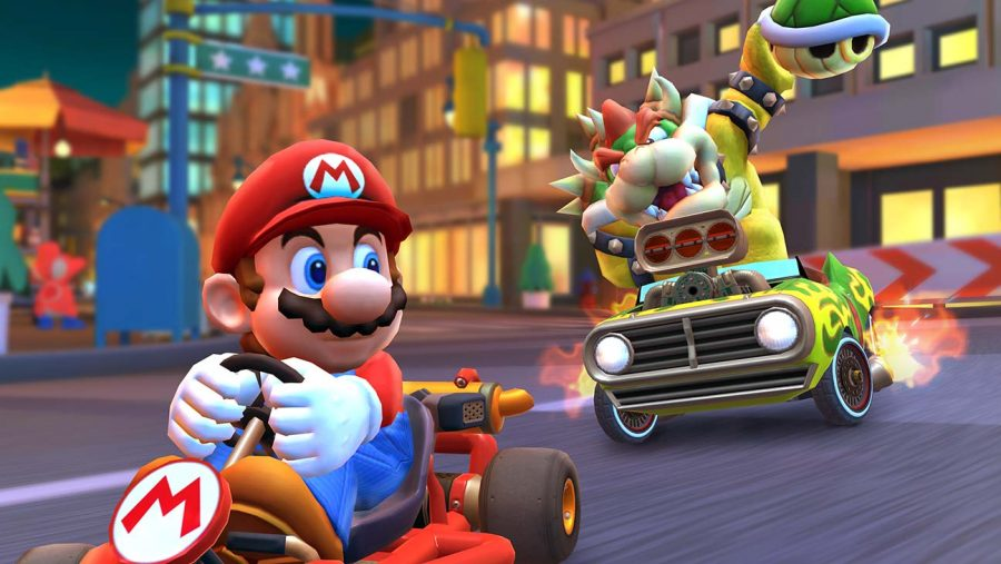 Bowser+chases+down+Mario+in+Nintendo%E2%80%99s+newest+game%2C+Mario+Kart+Tour.+The+game+is+currently%0Afree-to-play+on+all+IOS+devices.