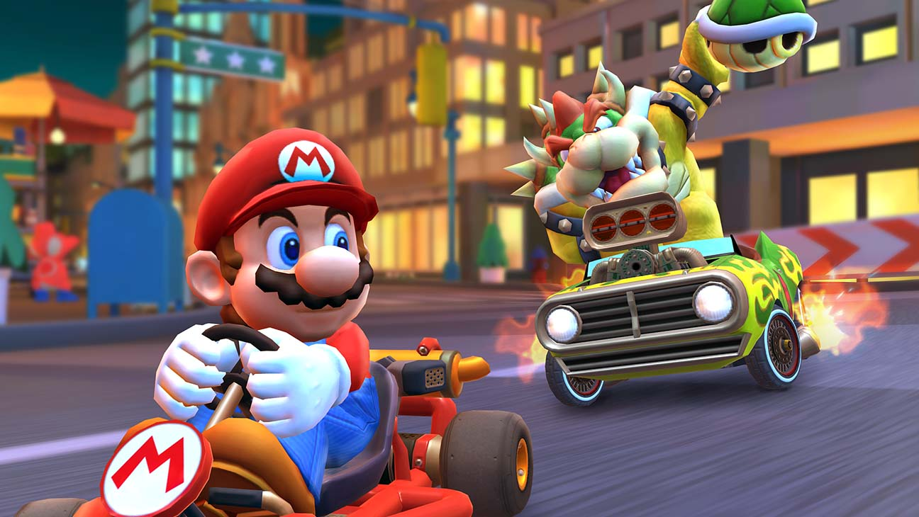 Bowser chases down Mario in Nintendo's newest game, Mario Kart Tour. The game is currently free-to-play on all IOS devices.