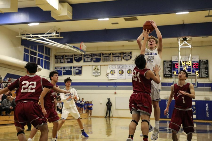 Junior Brock Susko overwhelms Cupertino defense and leaps over players to help Los Altos achieve their win.