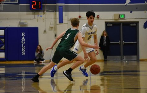 Varsity boys basketball breaks undefeated streak