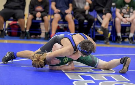 Sophomore Greg Schumann gains the upper hand in his match against Homestead.