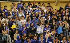 Los altos students fill the bleachers with their blue spirit  and posters.