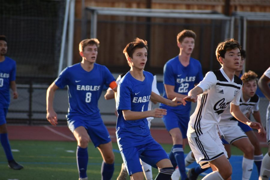 (Left to Right) Senior Jack Chmyz, freshman Ardi Heinz and junior Gavin Fairey prepare for an incoming corner kick. The Eagles lost to Leigh High School 1-2 in CCS quarterfinals.