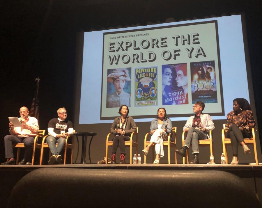 Assistant Principal Galen Rosenberg and school librarian Gordon Jack sit with Young Adult novelists Stacey Lee, Mitali Perkins, James Brandon and Nya Jade to discuss their award-winning titles and writing craft. The Q&A session was held on Tuesday, March 3, in the Eagle Theater.