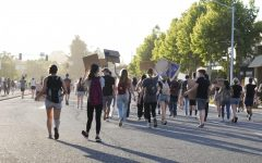 Protesters march on El Camino Real towards the intersection at San Antonio. Yesterday, protesters took to the streets of Mountain View and expressed outrage  over the killing of George Floyd by Minneapolis police officer Derek Chauvin.
