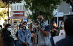 JT Faraji calls to the crowd through his bullhorn. On Friday, September 25, protesters gathered in Menlo Park, reacting to the grand jury indictment in Breonna Taylor's case.