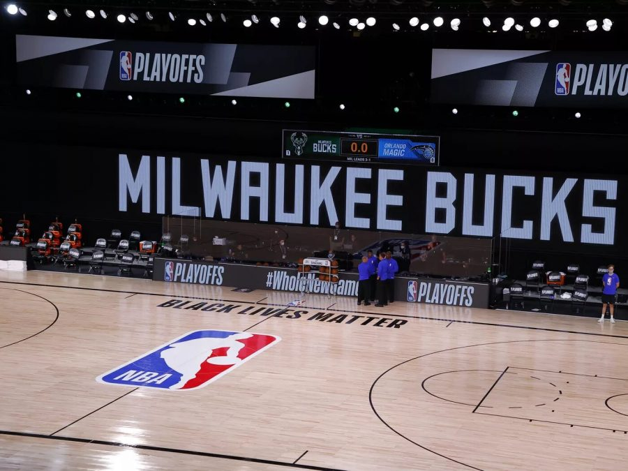 Referees gather together after the Milwaukee Bucks refuse to take the court against the Orlando Magic. After numerous games were canceled following the police shooting of Jacob Blake, a Black man in Kenosha, Wis., the NBA and NBPA talked with players and staff and released a joint statement announcing that teams would continue playing playoff games on Saturday, September 29.