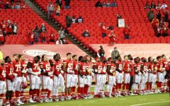 Players from the Kansas City Chiefs stand together and link arms in support for the BLM movement before their game