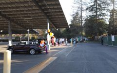 Cars in the Los Altos High School parking lot participating in the Halloween Grab and Go.