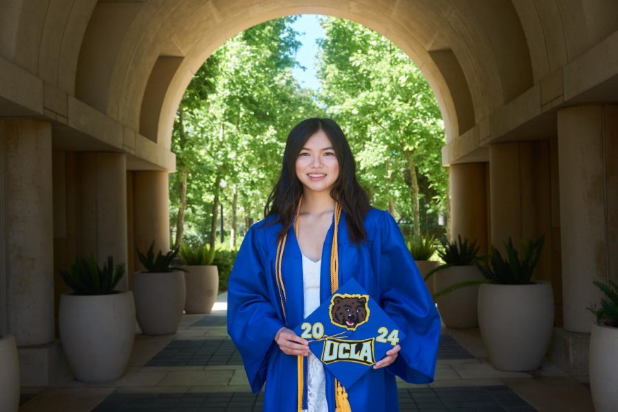 Alyssa Hamamoto, '20, donned in her graduation gear, is holding her University of California Los Angeles (UCLA) themed cap. Hamamoto, an incoming freshman at UCLA, is taking her courses from home to be close to her family and hopes to major in political science due to her passion for history and political theory.