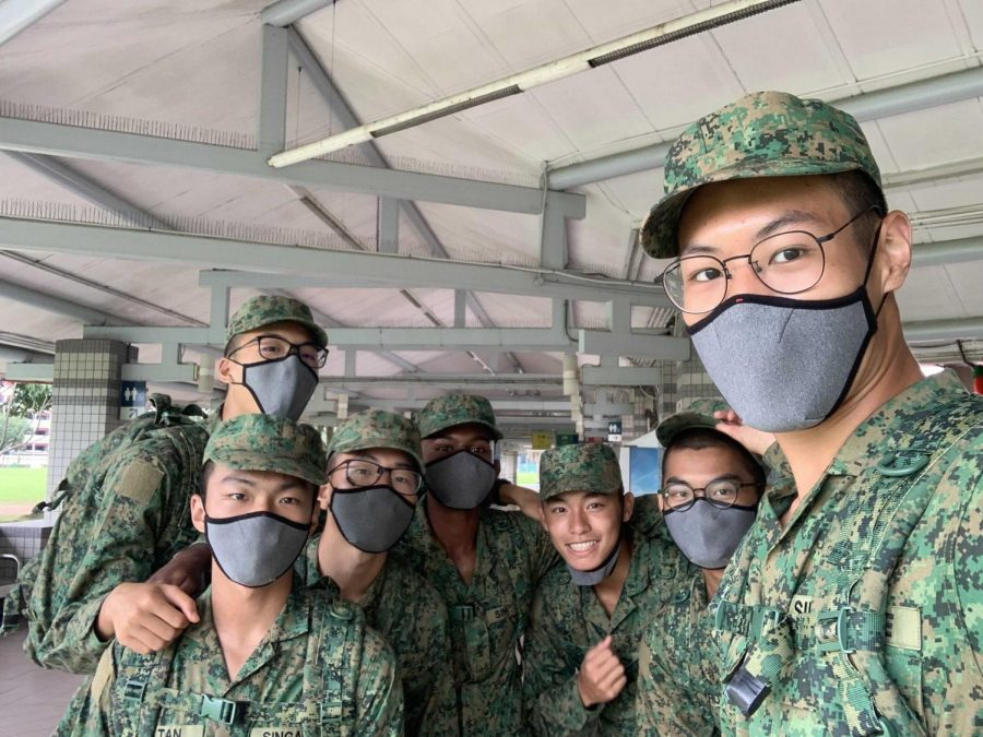 Daniel Lim (second row left) poses with his peers in the Singapore Army during training. Lim is serving two years of mandatory service in the country while bonding with his platoon and strengthening his leadership skills in the process.