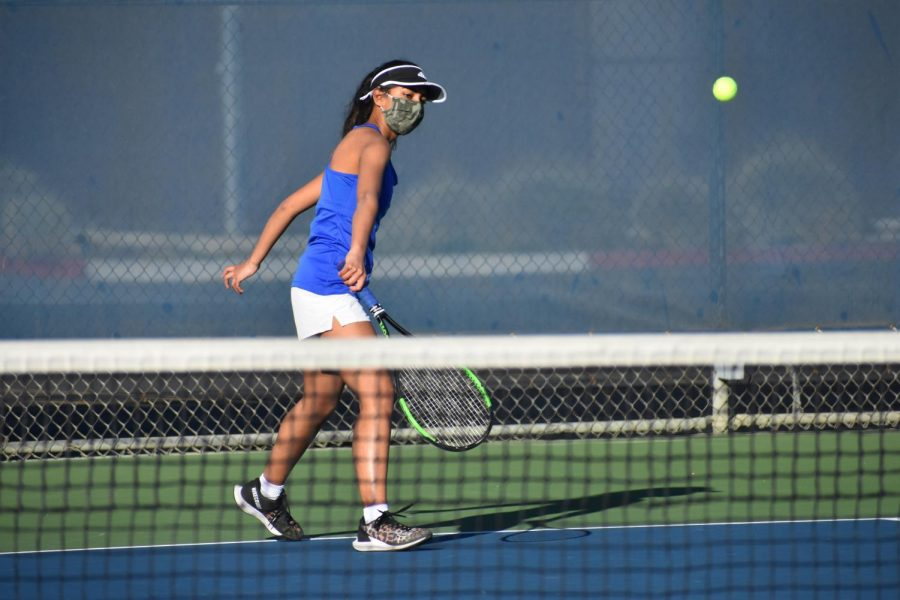Senior Navya Singhai hits a clean backhand slice in a doubles match against Lynbrook. The varsity girls tennis team won two out of their four singles matches and won all three of the doubles matches played, taking the victory with a final score of 5-2.