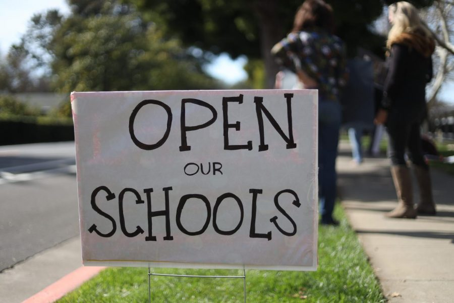 A protest usually consists of angered loud chants and bright, vibrant signs, but yesterday's gathering regarding school reopening looked quite the opposite. After the Mountain View–Los Altos School (MVLA) District released an updated rotating hybrid model, the gathering became a celebration of