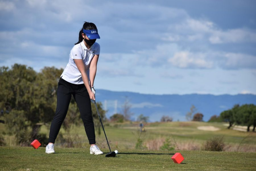 Sophomore Grace Cai lines up her swing as she prepares to take her first shot of the match. The girls golf team played a close game against Mountain View on Thursday, March 11, but pulled through with another win.