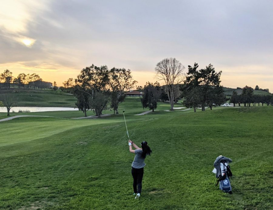 Senior Annika Gaglani takes her second shot on the last hole of her last high school match at the Bay View Golf Club. This year, the girls golf team only had two seniors — Annika and Joanna Hsieh — both of whom were recognized for playing all four years on varsity.