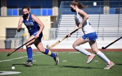 Senior Maura Kelleher chases after the ball alongside a Presentation player. The Eagles beat the Panthers in a 2–0 shutout at their last home game of the season, marking the team's 11 seniors' last game ever on LAHS turf.