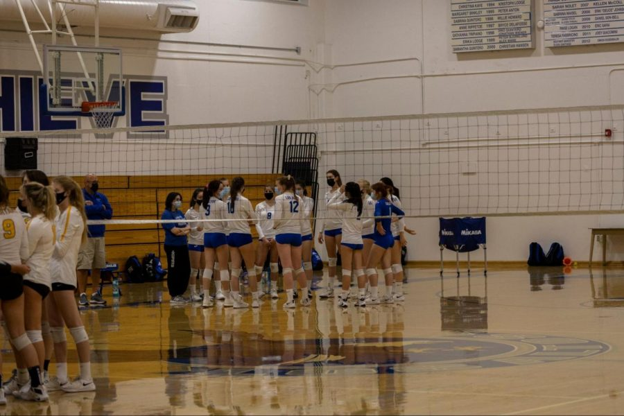 The Eagles huddle up before their rivalry match against Mountain View High School. Though MVHS was missing some senior players, the match was still a close fight.