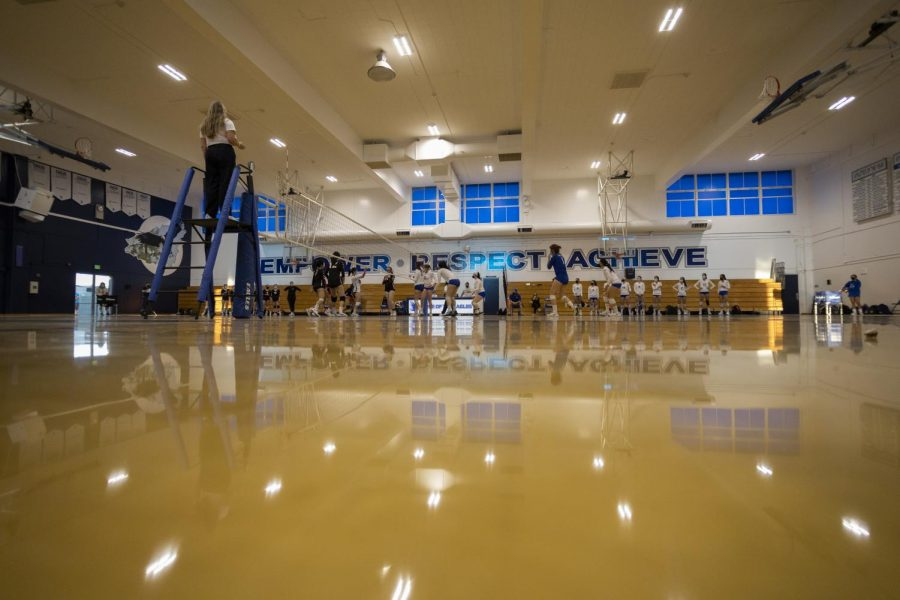 The girls volleyball team faces off against Gunn in the first indoor competition at LAHS in over a year. The team hopes to overcome some of the obstacles brought on by COVID-19 by bonding with each other.