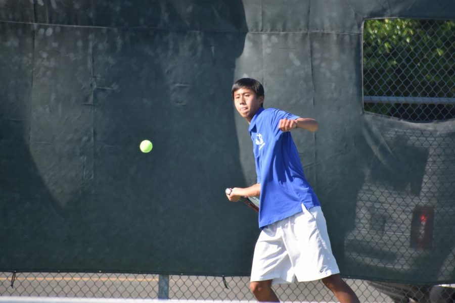 Senior Ethan Lowe prepares to return an incoming serve. In their most recent rematch against MVHS, the varsity boys tennis team won 6–1.