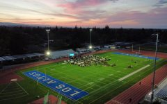 Students attend Seniors Under the Stars, held on the football field.