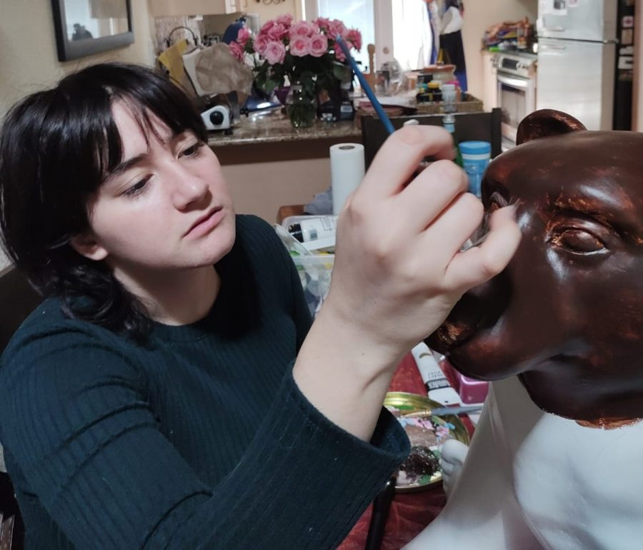 Senior Alessia Cis works on her Roman Bear, one of many painted bears that can now be found throughout Downtown Los Altos. The project, organized by the Los Altos Rotary Club, has offered professional opportunities to various local artists.