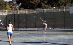Senior Rose Liu serves during a doubles match against Mountain View High School. Due to limited court space at Mountain View High School, MVHS is sharing court space with the Los Altos High School girls tennis team, leaving the Eagles with little practice time.