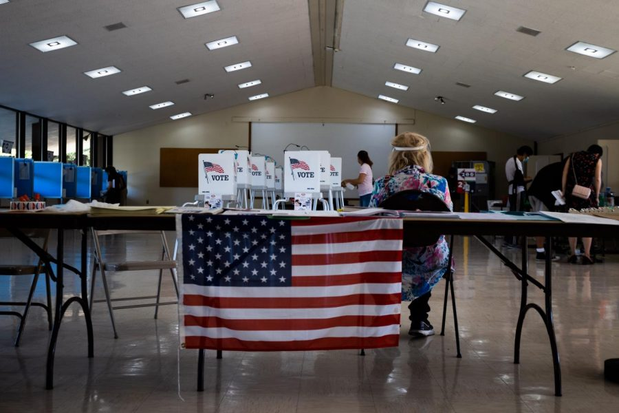Poll worker observes stations at Los Altos Youth Center.