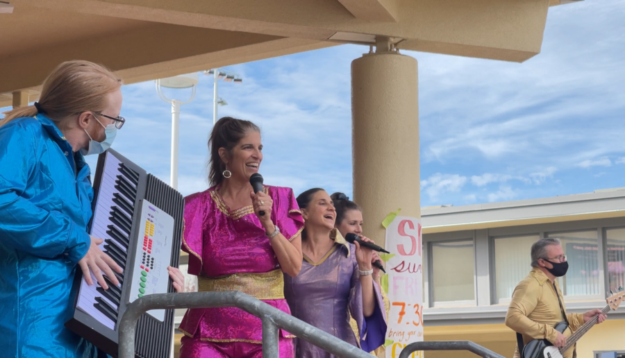 """Performing arts teachers lip sync along to ABBA's """"Mamma Mia,"""" which will be this years musical."""